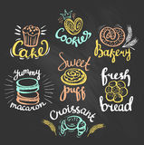 Set of color bakery logos on the chalkboard. Bakery labels. Royalty Free Stock Photo