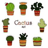 A set of color cactuses in pots in the Mexican style. White background Royalty Free Stock Photo