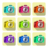 Set of color cameras on colored backgrounds in a flat design. Set of color cameras with lens on colored backgrounds in a flat design with shadow. Vector royalty free illustration