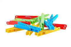 Set color clothes-pegs over white Royalty Free Stock Photography