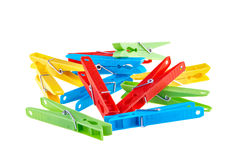 Set color clothes-pegs over white Royalty Free Stock Image
