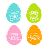 Set of color easter eggs with handwritten wishes of a Happy Easter. Royalty Free Stock Photography