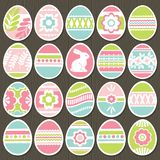 Set of color easter eggs over brown wooden background. Holiday Easter Eggs decorated with flowers, rabbit, leafs. Easter holidays. Print design, label, sticker royalty free illustration