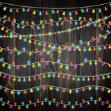 Set of color garland lights. Glowing christmas lights on wooden background. Includes 10 vector brushes festive strands. Set of color garland lights. Glowing vector illustration