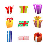 Set of color gift boxes with bows and ribbons isolated on white background. Royalty Free Stock Photos