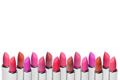 Set of color lipsticks arranged in line isolated on white background. A row of red, pink and wine lipstick with free Stock Photos