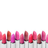 Set of color lipsticks arranged in line isolated on white background. A row of red, pink and wine lipstick with free Stock Images
