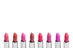 Set of color lipsticks arranged in line isolated on white background. A row of red, pink and wine lipstick with free Royalty Free Stock Photography