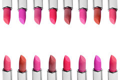 Set of color lipsticks arranged in line isolated on white background. A rows of red, pink and wine lipstick Stock Image