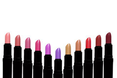 Set of color lipsticks forming V shape. Lipstick set isolated on. White background stock photography