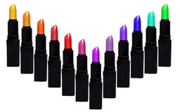 Set of color lipsticks forming V shape. Lipstick set isolated on. White background royalty free stock photography