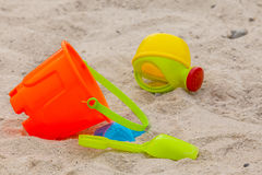 Set of color plastic toys on a sand. Close-up Stock Images