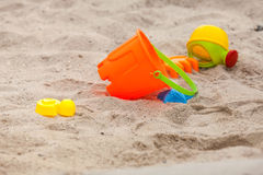 Set of color plastic toys on a sand. M close-up Royalty Free Stock Photos