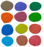 set of 12 color plasticine abstract shape texture on white Stock Images