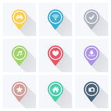 Set of color pointers and markers for map and plan with white icons on grey background. Royalty Free Stock Photo