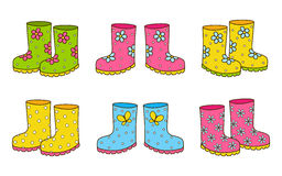 Set of color rubber boots. On white stock illustration