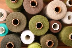 Set of color sewing threads on table Stock Photography
