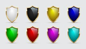 Set of color shields icons with golden frames isolated on white background. Vector design elements. stock illustration