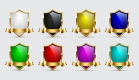 Set of color shields icons with golden frames and ribbons isolated on white background. Vector templates. stock illustration
