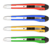 Set of color stationery knifes. Royalty Free Stock Photos