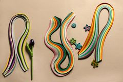 set of color strips for quilling with a sample of paper flowers this  technique royalty free stock photography