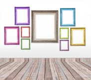 Set of color vintage picture frames on the wall Stock Photo