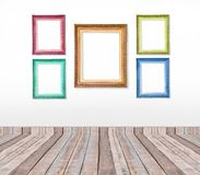 Set of color vintage picture frames on the wall Stock Photography