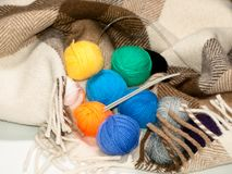 A set of color woolen yarns for knitting in a rug Royalty Free Stock Photo