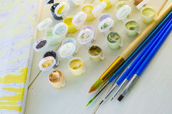 Set of colored acrylic paints Stock Photos