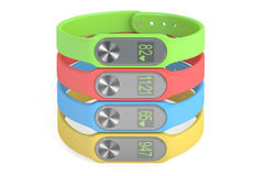 Set of colored activity trackers or fitness bracelets, 3D render Stock Photography