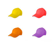 Set of colored baseball caps on a white background. Royalty Free Stock Photography