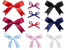 Set of colored bows cut out on white background Royalty Free Stock Images