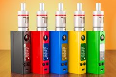 Set of colored box mods electronic cigarettes on the wooden tabl. E. 3D Stock Image
