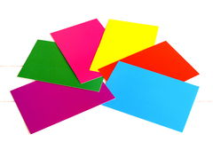 A set of colored cardboard  on white background. Red, yellow, green, blue, purple, pink paper sheets Royalty Free Stock Image