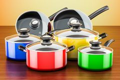 Set of colored cooking kitchen utensils and cookware. Pots and p. Ans on the wooden table royalty free illustration