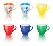 Set of colored cups  on white background. Royalty Free Stock Photography