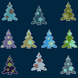 Set of colored firs decorated with snowflakes Stock Photo