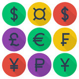 Set of colored flat icons with currency symbols. Set of colored flat icons with different currency symbols on multicolor round backdrops Royalty Free Stock Images
