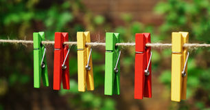 A set of colored garden pegs on a vintage garden string Royalty Free Stock Image