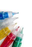 Set of colored glitter glue tubes Stock Photo