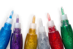 Set of colored glitter glue tubes on white with path Stock Photo