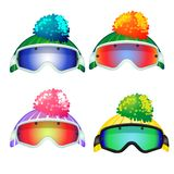 Set of colored goggles of the skier and the knitted hats with pompon isolated on white background. Vector cartoon close vector illustration