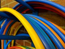 A set of colored hula hoops hanging on a blue peg royalty free stock photography