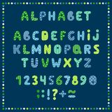 Set of colored letters and numbers. Childrens alphabet. Font for kids. Bright colors, blue, green, yellow on blue background. royalty free illustration