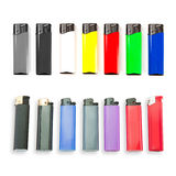 Set of colored lighters on white background. Stock Photo