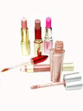 Set of colored lipsticks and lip gloss Stock Photos