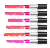 Set of colored lipsticks with trace on white background Stock Photos