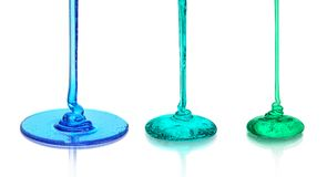 A set of colored liquids that pours on the glass surface. Isolated Royalty Free Stock Photos