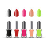 Set of colored nail lacquer bottles. On white background Royalty Free Stock Photography