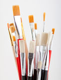 Set of colored paintbrushes on a gray background. Royalty Free Stock Photo